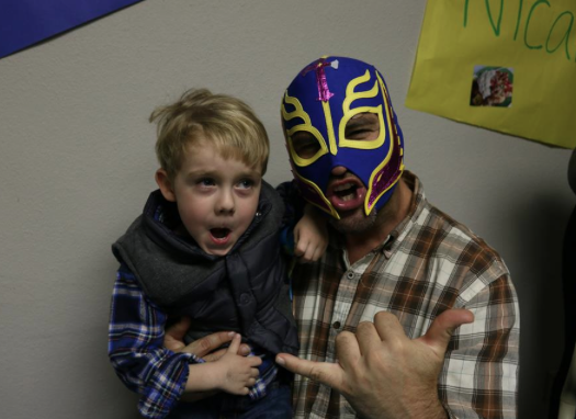 The luchador (traditional wrestler) at the Mexico booth poses with an excited world traveler!