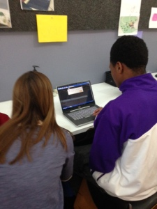 STEAM Studio volunteer helps HALO youth code and program a personalized video game.